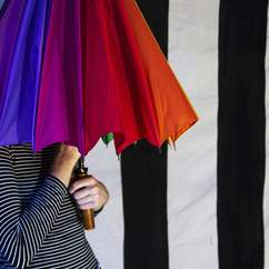 The Boy with the Rainbow Umbrella