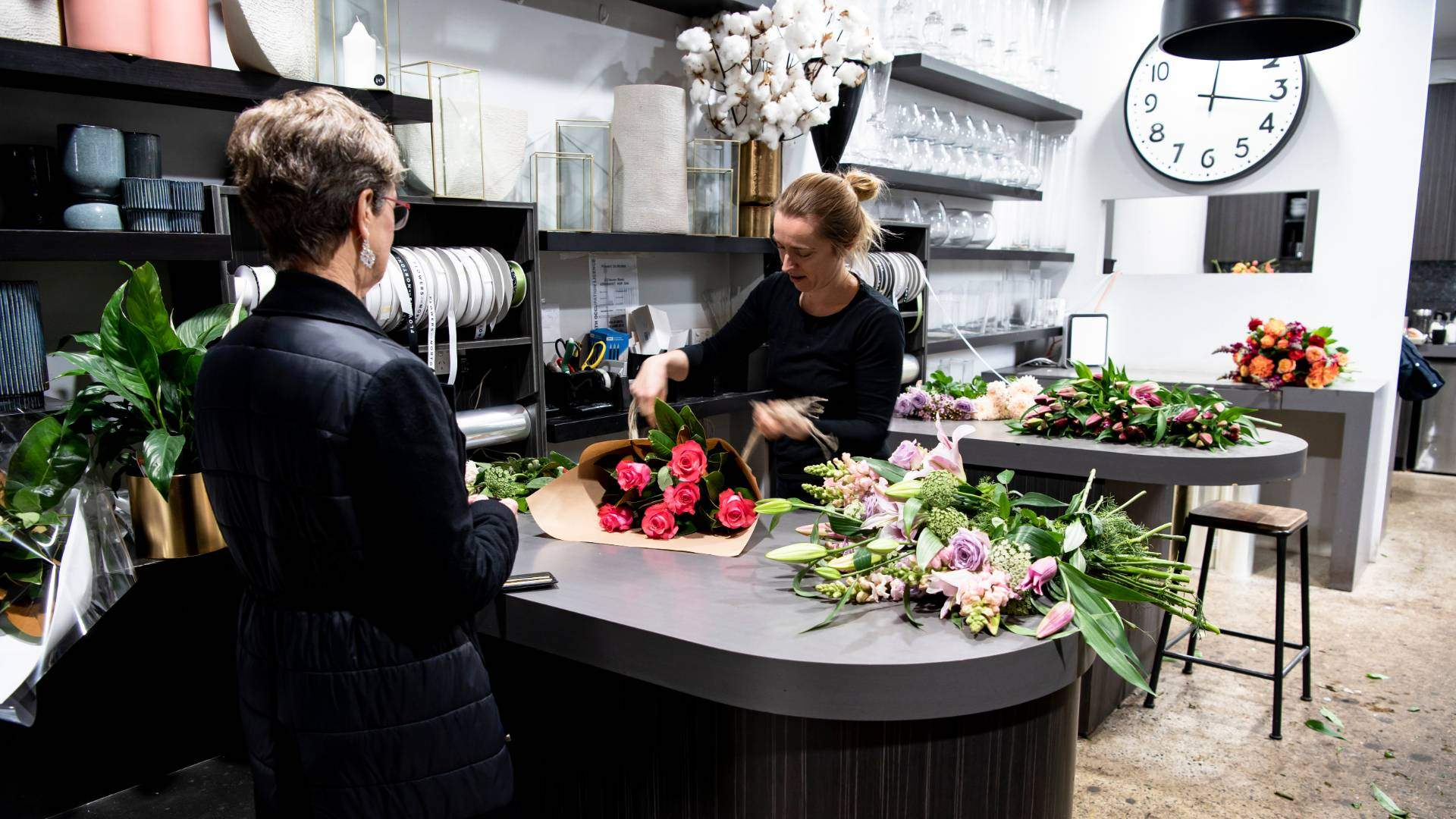 Florist and customer at Flowers on Norton St