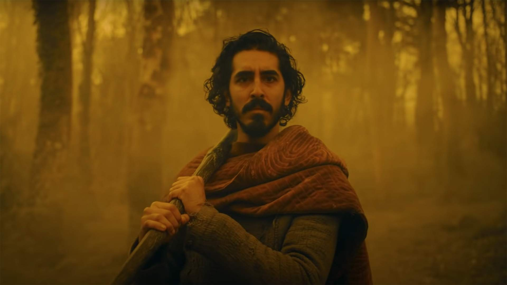 The New Trailer for 'The Green Knight' Pits an Axe-Swinging Dev Patel Against an Eerie Giant
